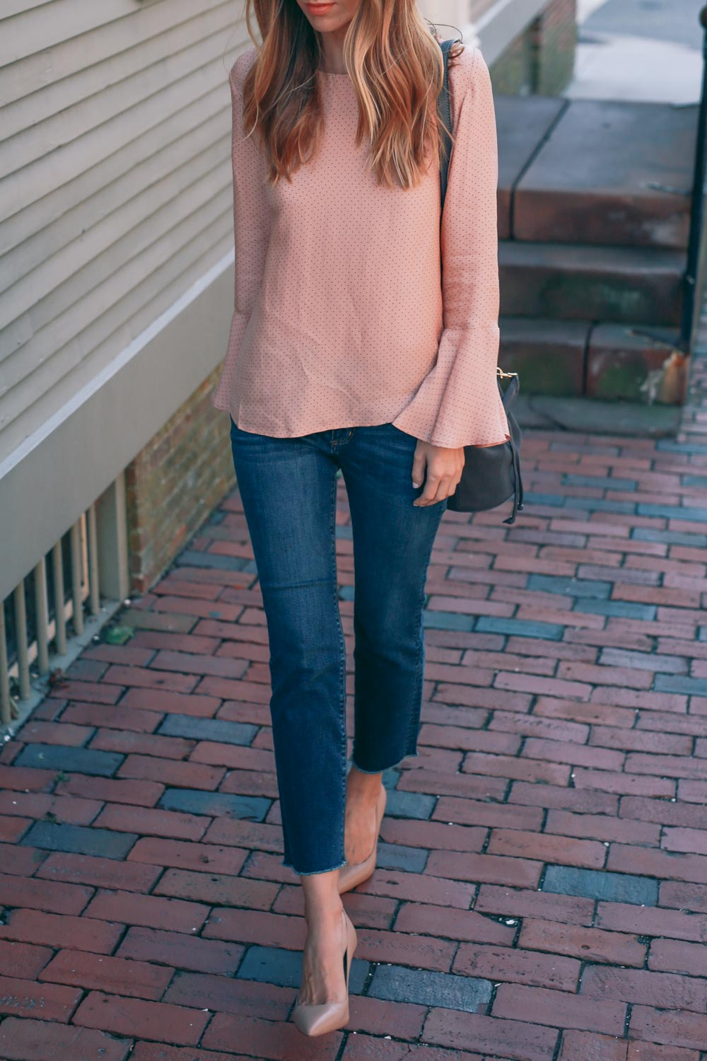 Bell sleeved blouses are both incredibly elegant and adaptable; Jess Ann Kirby pairs this piece with jeans, but it could also be worn with a mini or maxi skirt, depending on occasion.   Outfit: Ann Taylor.