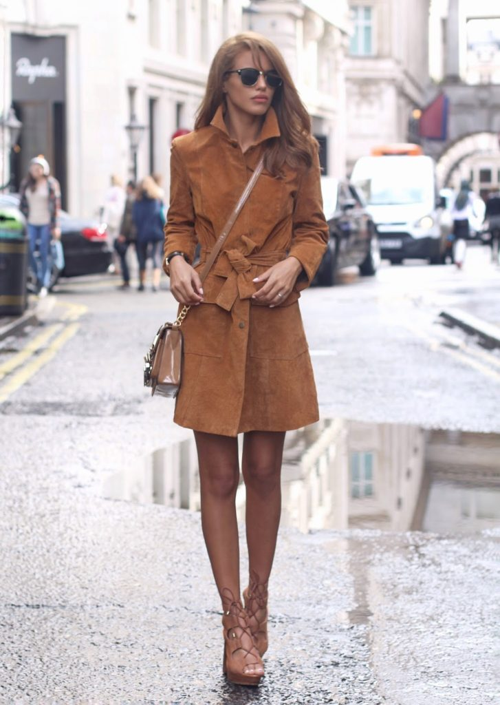 Nada Adelle wears cute brown jacket with pale heels and bag.   Brands not specified.