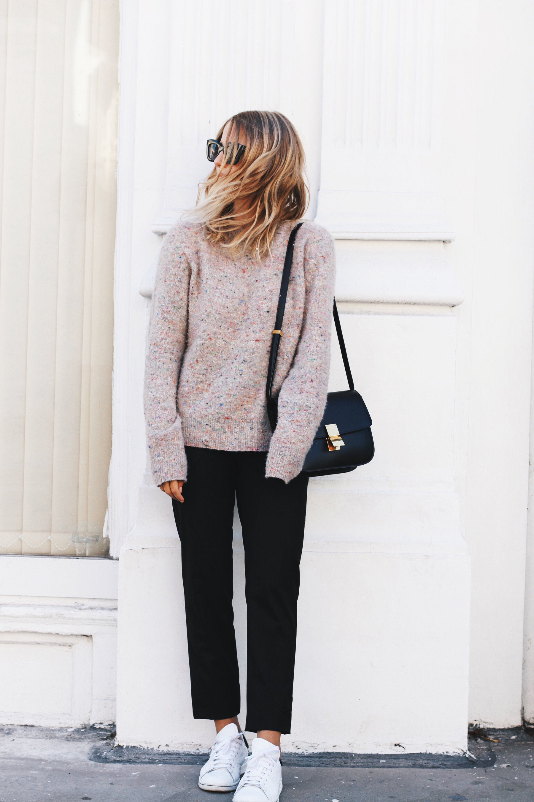 Black cigarette trousers go great with a pastel knit. Via mijaflatau.com. Knit jumper: ACNE studios, Bag: Celine.