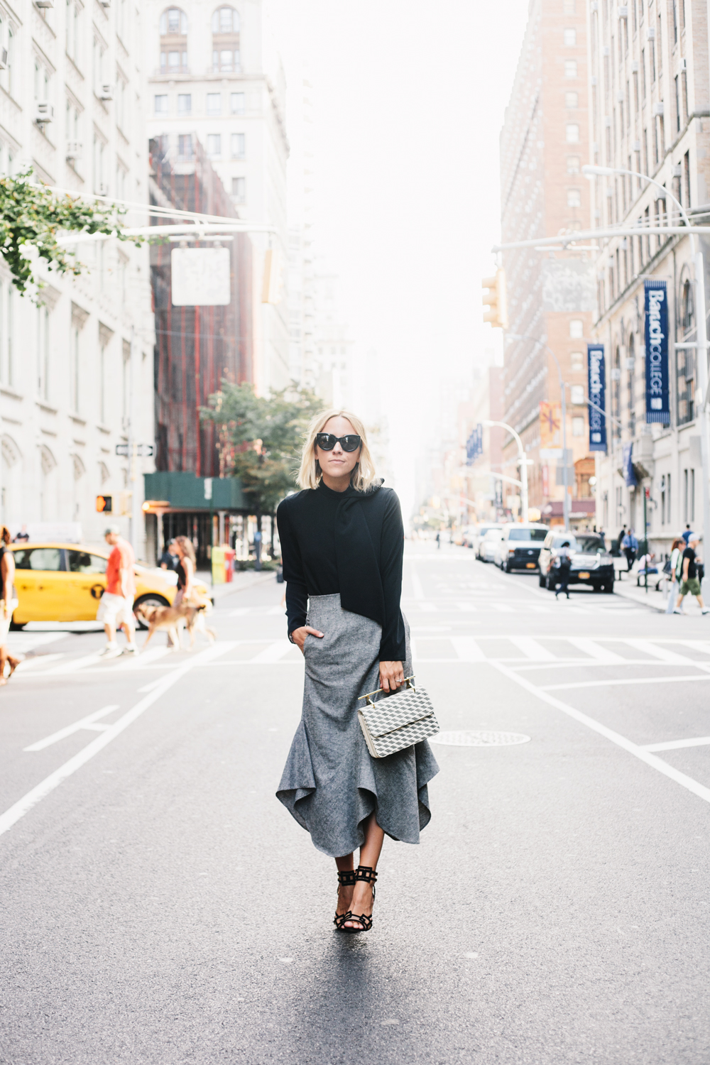 Try pairing a black bow top with a statement grey skirt this fall. Via Jacey Duprie. Bow Top: TY-LR Reniard, Skirt: Sam & Lavi.