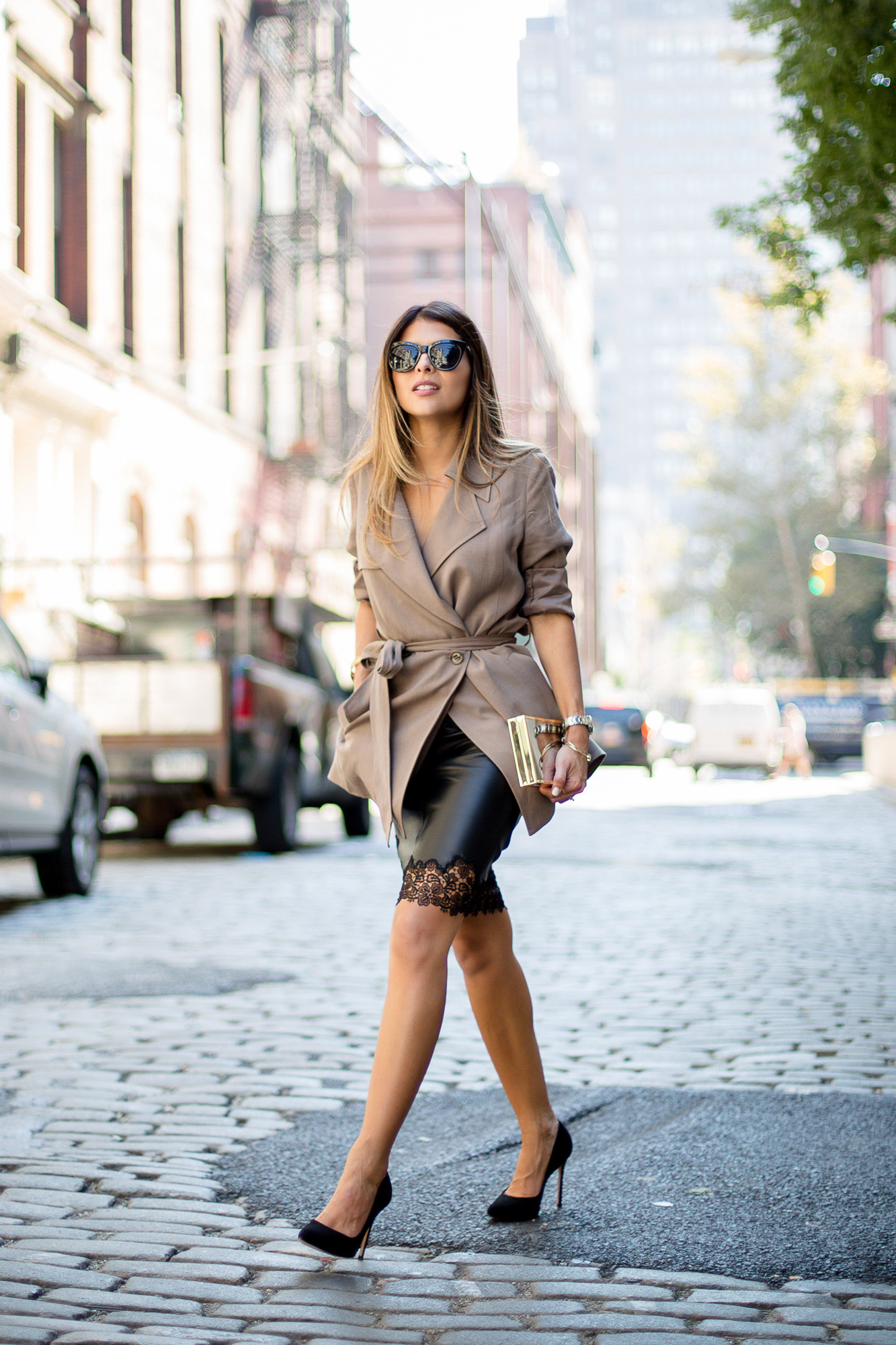 Pam Hetlinger rocks this beige trench and leather skirt. Skirt/Trench/Pumps: Reiss.