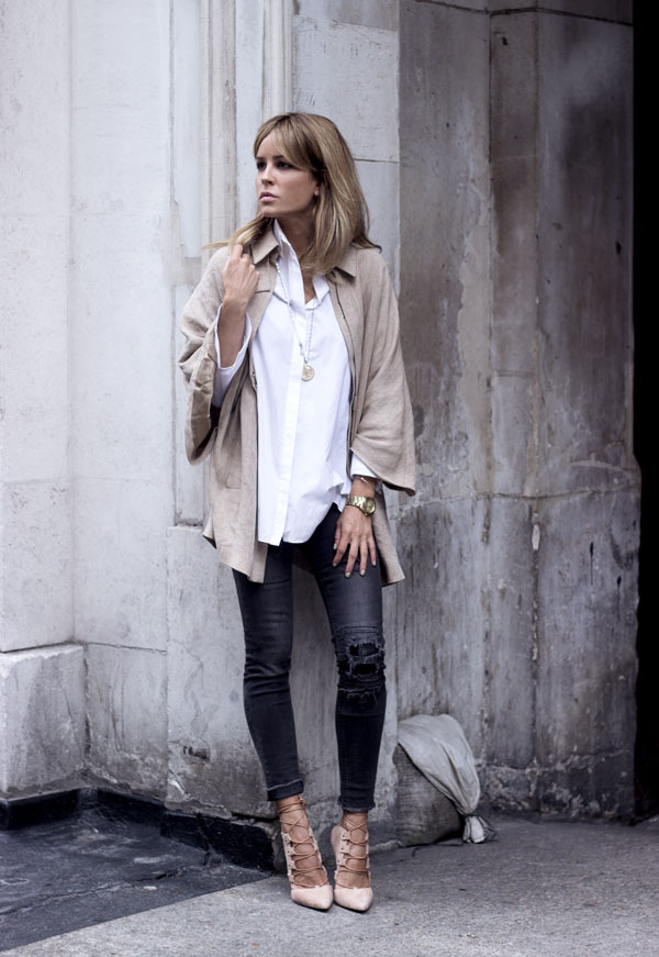 A white shirt and black skinnies are always a winner. Combine with strappy heeled sandals to add edge to your outfit. Via Isabel Sellés. Jacket: Massimo Dutti.