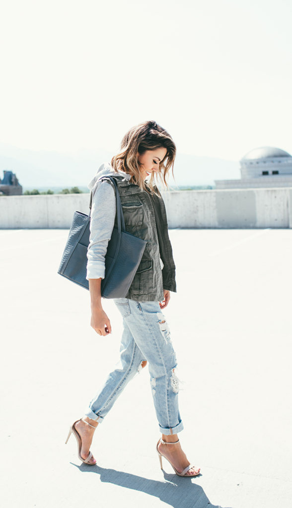 Wear an army vest and a grey hoodie and pair that with ripped jeans and heels this Fall. Via Christine Andrew