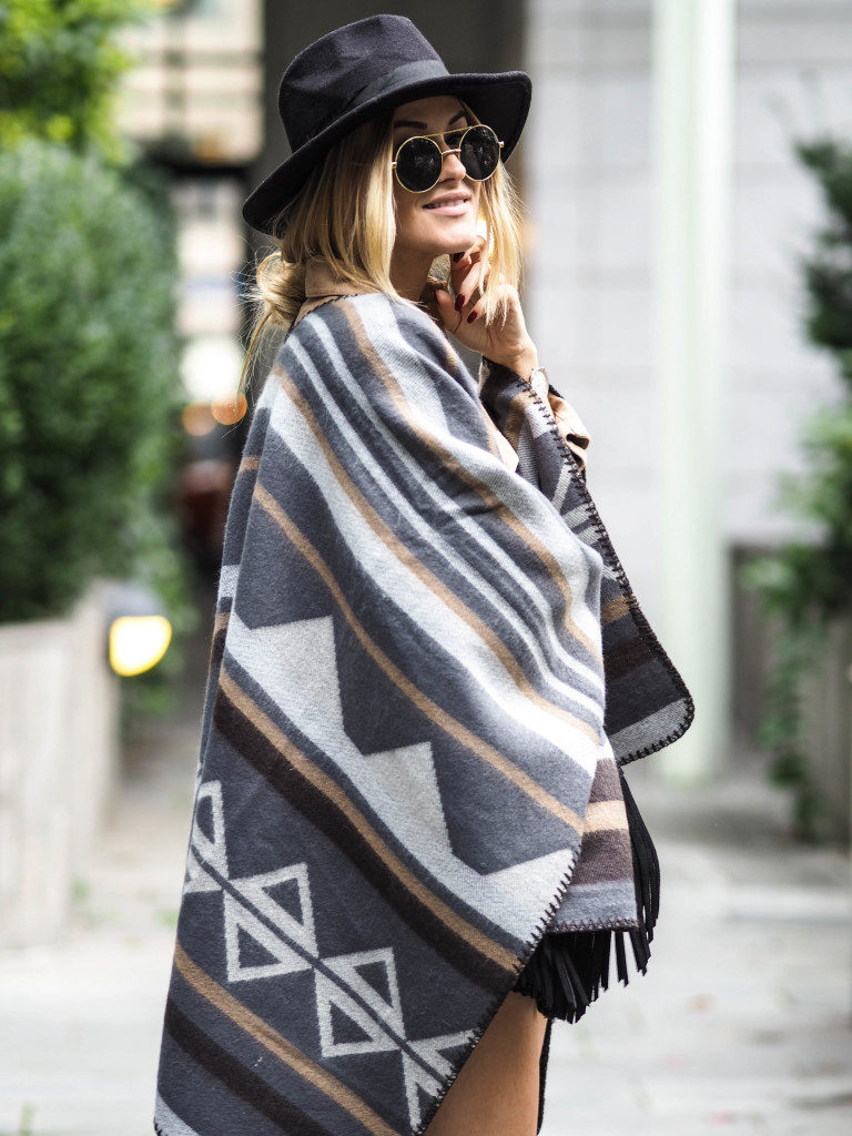 Lene Orvik pairs this cute fedora with oversized aztec poncho and shades.  Hat: Shein, Poncho: Miss Selfridge.