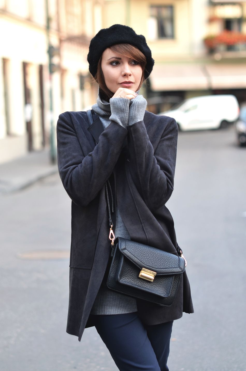 Kamila Leciak looks cute in a beret and pullover. Trousers: Preska, Coat: Tova.