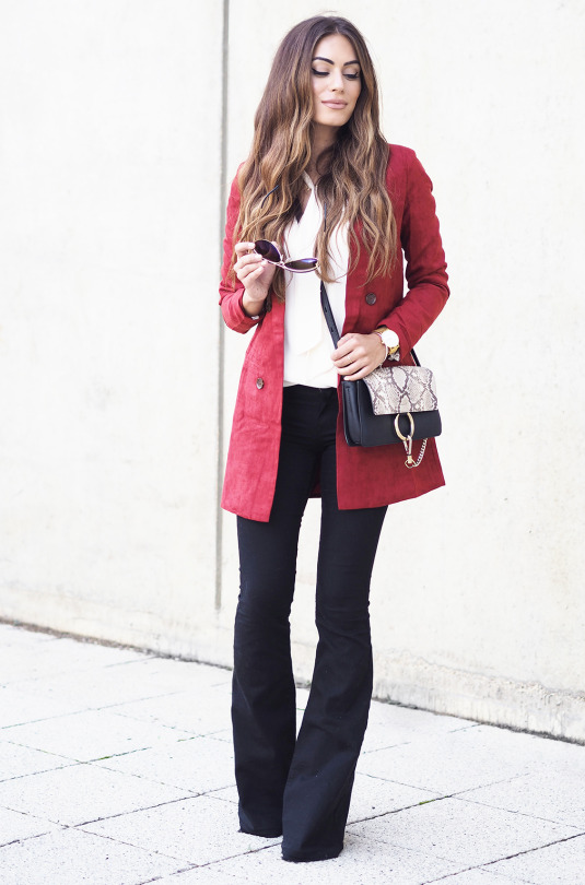 Lydia Lise Millen wears deep red blazer with stylish wide leg trousers and cute bag. Blazer: Missguided.