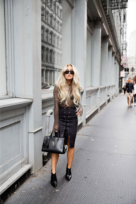 This tie front midi skirt looks hot with a netted top and black ankle boots. Via Angelica Blick. Top: H&M Studio, Bag: YSL, Skirt: ASOS.