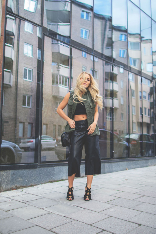 Try wearing leather culottes with an army-style jacket for an edgy, individualistic look. Via Angelica Blick. Vest: Milk It, Trousers: River Island, Shoes: Zara.