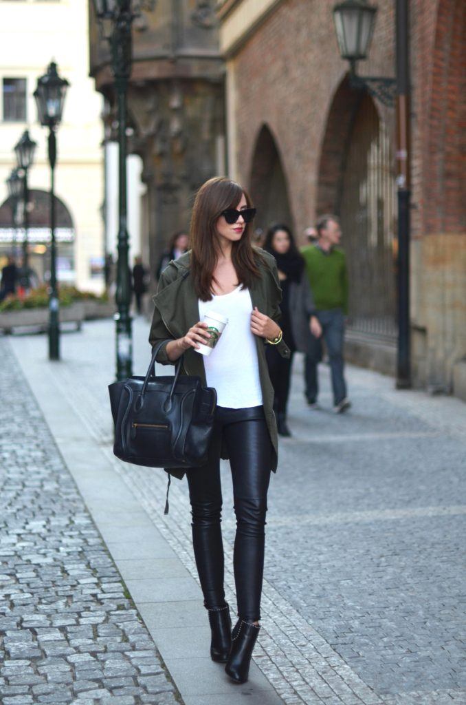 Barbora Ondrackova looks ultra chic in a pair of skinny leather trousers and a khaki jacket.   Jacket: Topshop, Bag: Celine.