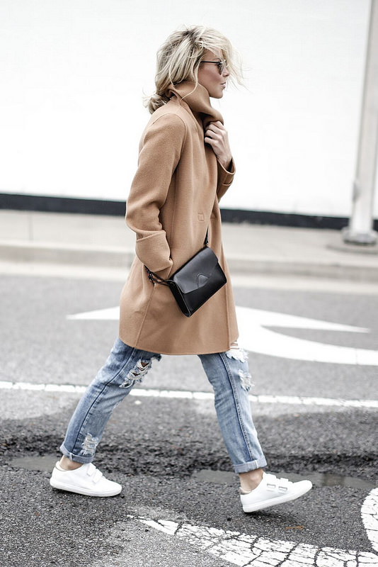 Mary Seng exudes boyish charm in this brown jacket and ripped jeans. Coat: Vince, Tee: Nordstrom, Jeans: Onedenim.