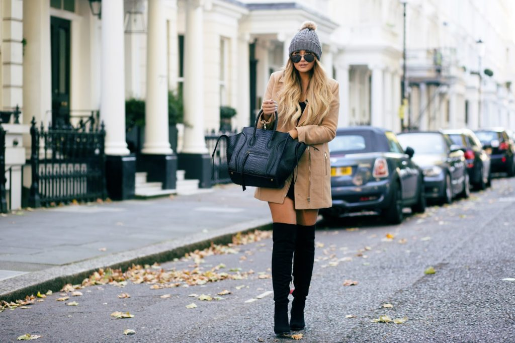 Over the knee boots are all the rage this fall. Try pairing yours with a camel jacket and woolly hat like thatpommiegirl.com.  Dress/Coat/Hat: Missguided.