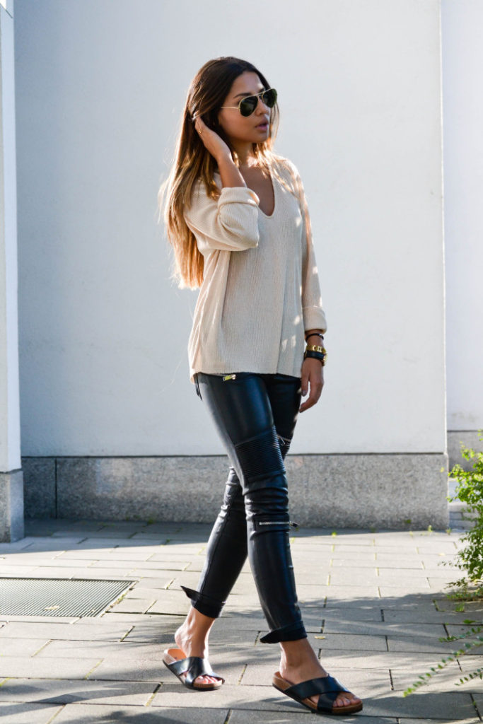 Is this the perfect outfit for transitioning from Summer to Fall. Via Consuelo Paloma   Sweater/Leather Pants: Zara, Shoes H&M, Sunglasses, Shades: Ray-Ban