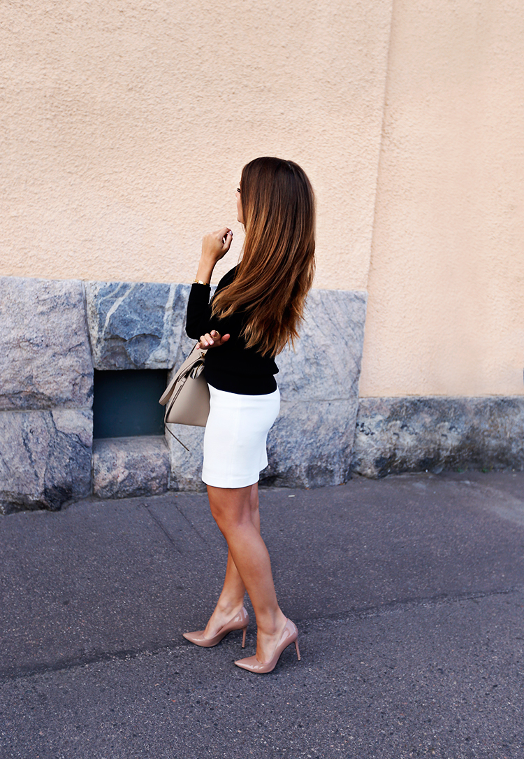 Marianna Mäkelä wears white bodycon skirt with cute black blazer. Sweater/Skirt: Tiger of Sweden, Heels: Roberto Festa, Bag: Céline.