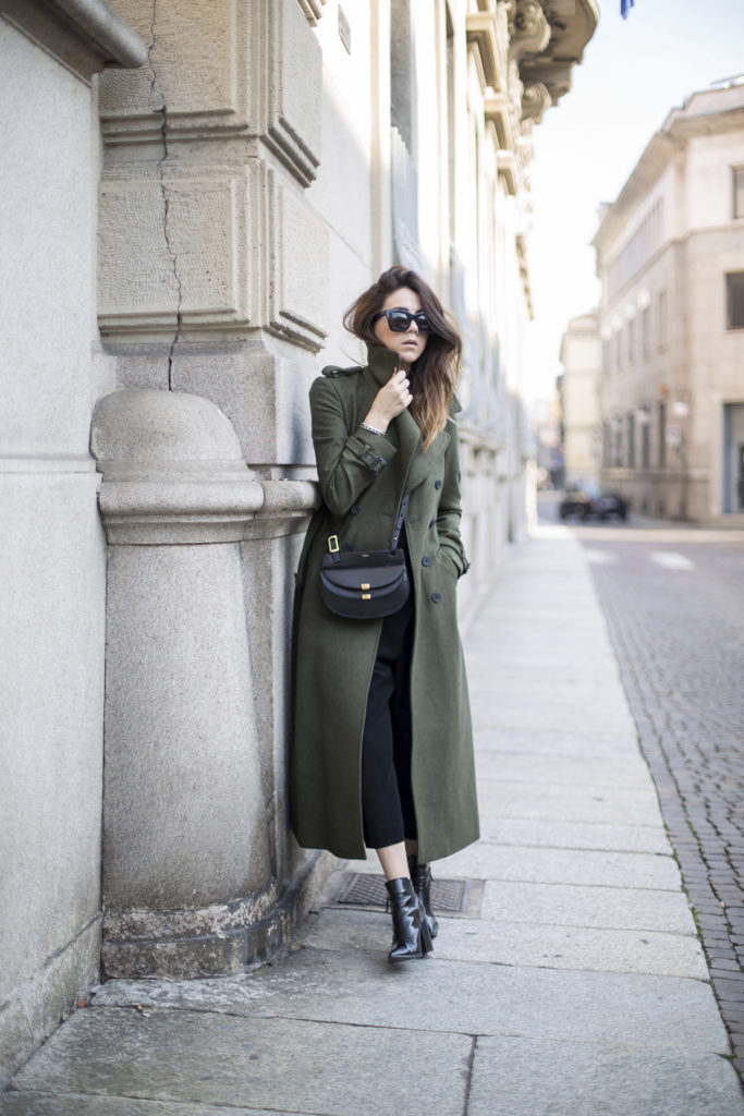 Nicoletta Reggio wears a khaki army-style maxi coat with black culottes and ankle boots.   Coat: Asos, T-shirt: Zara, Trousers: Balenciaga, Bag: Chloe, Shoes: Sarenza.