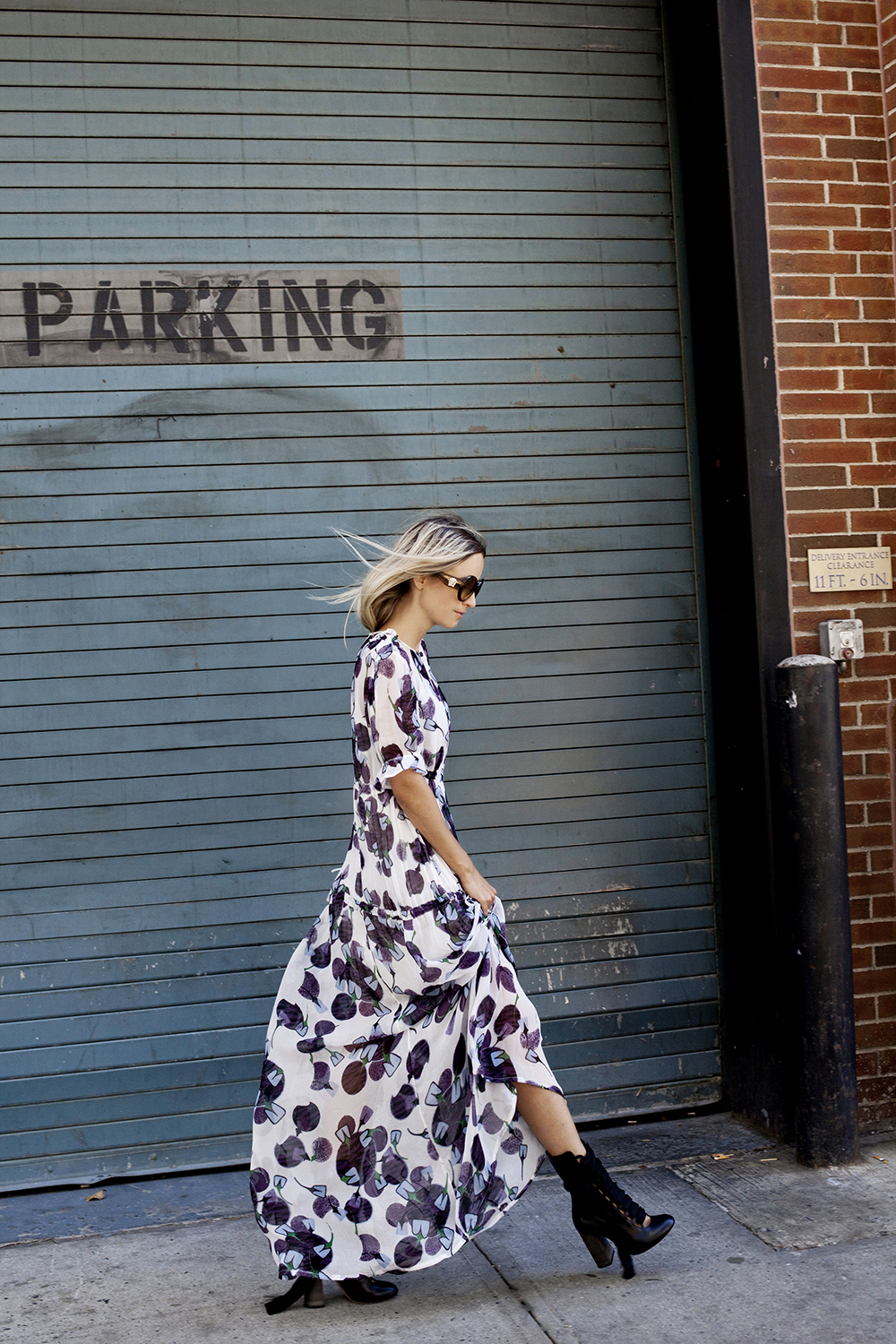 Charlotte Groeneveld looks effortlessly feminine in this gorgeous floral printed maxi dress, worn with edgy black ankle boots and classic sunnies. We love this look for when summer comes round! Dress: Baum und Pferdgarten SS16, Bag/Boots: Chloe.
