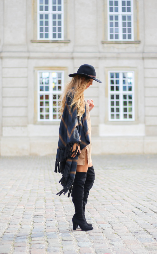 These over the knee boots go a treat with an oversized poncho and wide brimmed hat. Via Sandra Willer. Boots: ASOS, Poncho: Pulz Jeans.