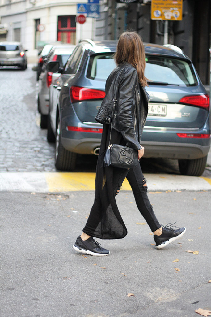 Vanja Milicevic's rocker girl style consists of distressed black jeans, sneakers, and a classic leather jacket.   Jeans: Mango, T-Shirt/Jacket: Zara, Bag: Gucci, Sneakers: Adidas.