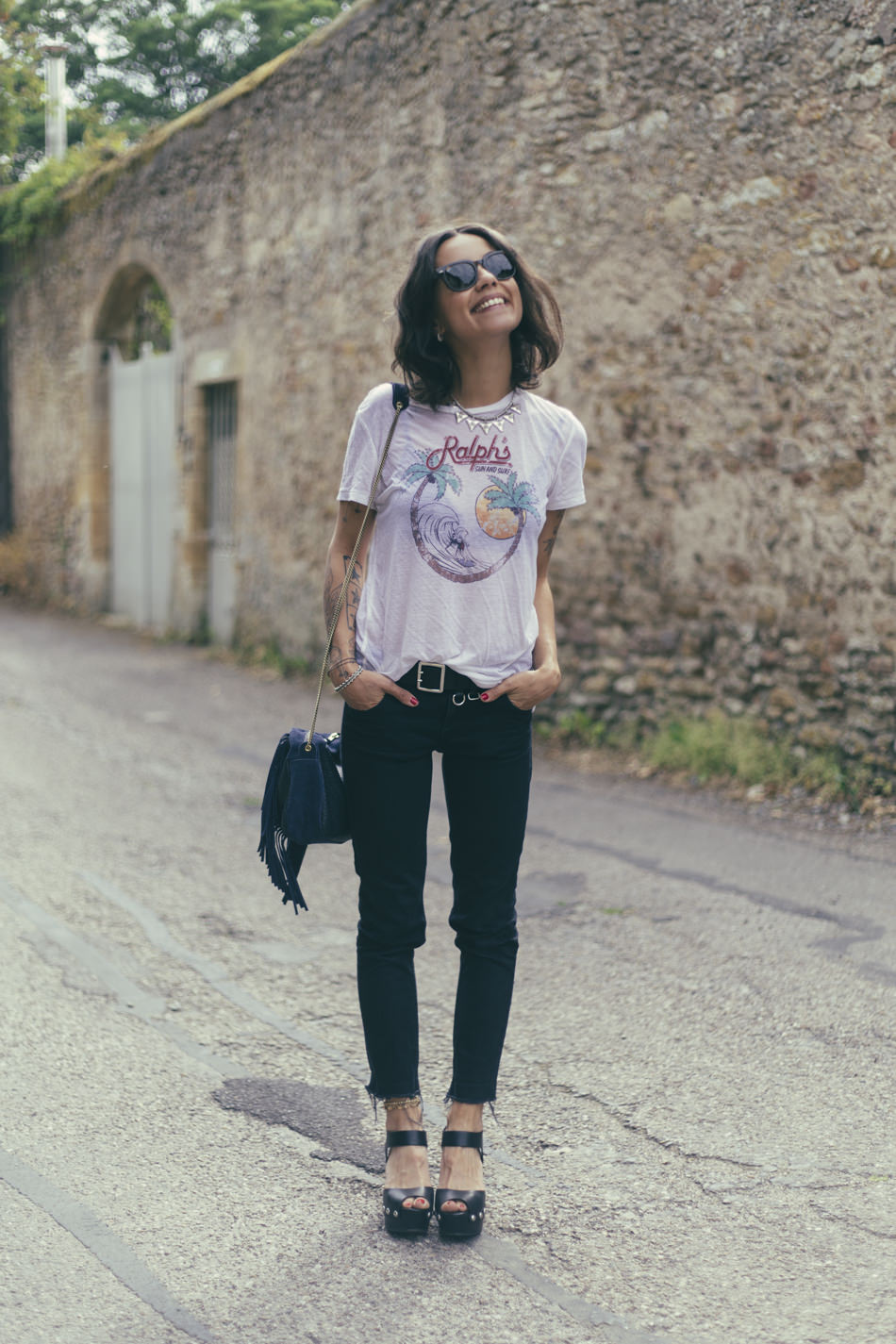 So the tattoo's adds to the overall rocker look, but the statement T-shirt, black skinnies and platforms completes it. Via Coline. T-shirt: Denim&Supply, Jeans: 001 Sezane, Shoes: River Island, Bag: Créations Sacs Mary