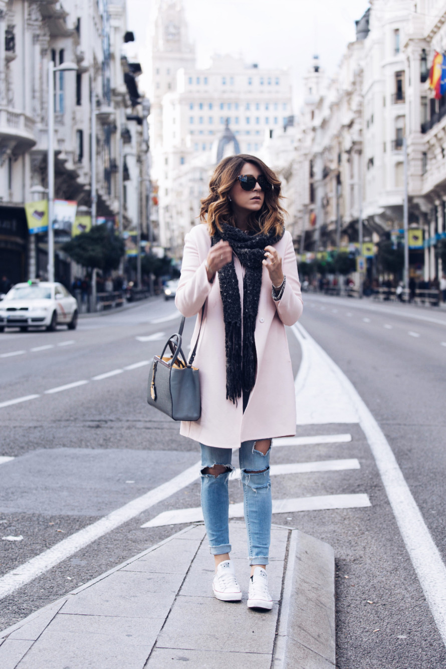 Wearing your white converse with a pastel coloured coat will create a wonderful autumn look. Nicoletta Reggio wears this outfit with distressed jeans and a cute grey scarf. Coat: Prada, Sweater: Romwe, Scarf: Zara, Jeans: Zara, Shoes: Converse: Sarenza.it, Bag: Fendi from Gasmy.it.