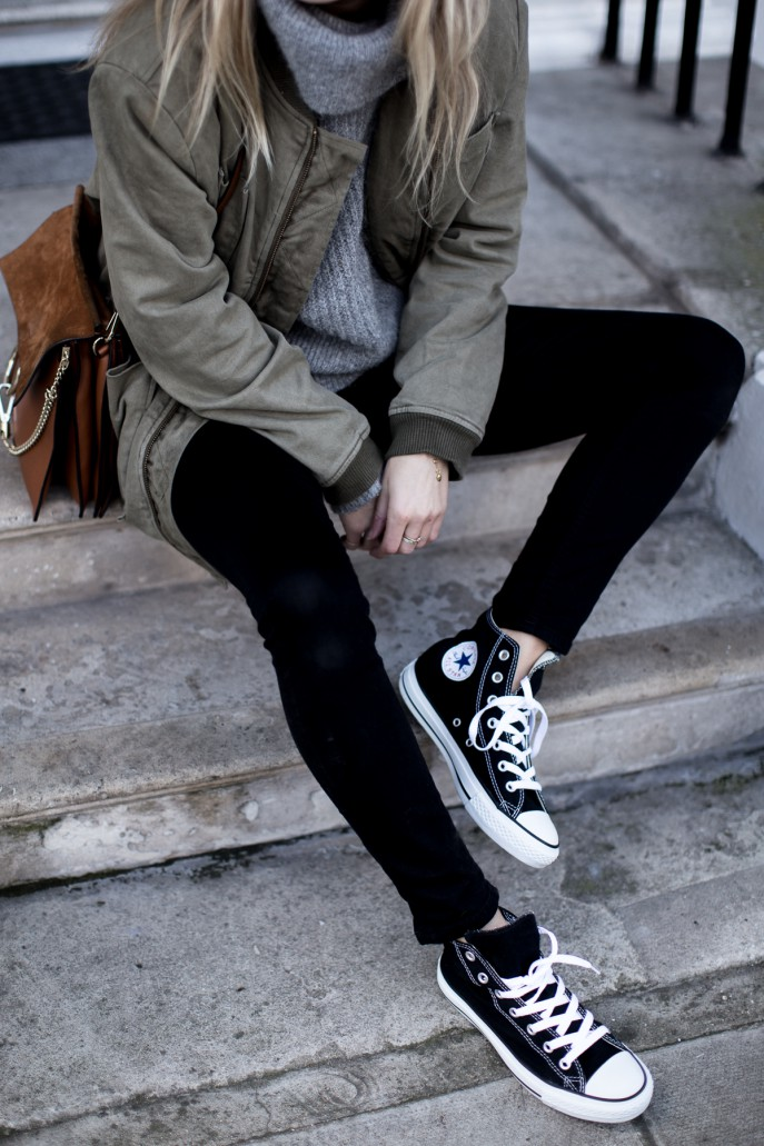 Wear your converse with loose laces to get the casual feel demoed here by Lucy Williams. This look is perfect for hitting the streets or travelling due to its easiness and comfort! Jacket: Anine Bing, Jumper: & Other Stories, Jeans: Acne.