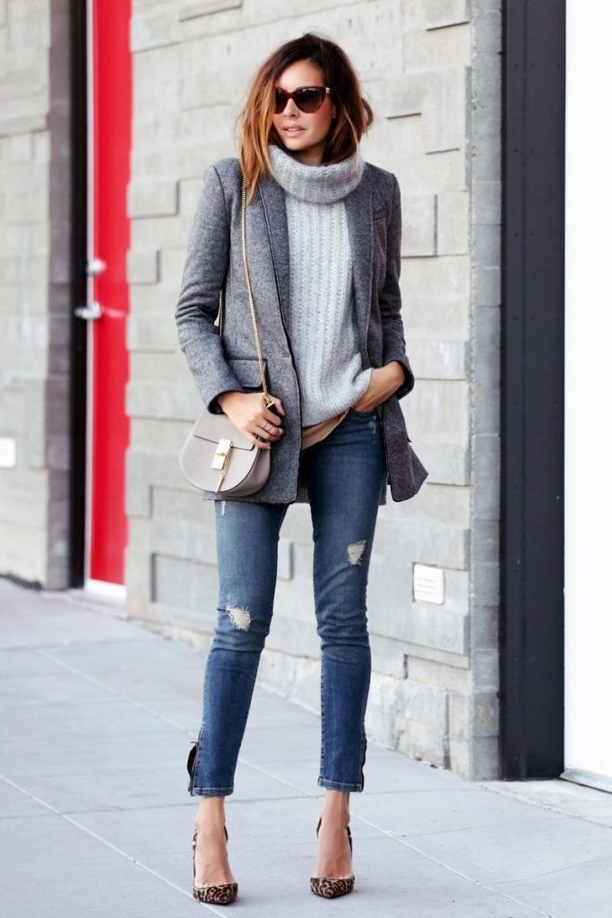 Erica Hoida wears cute chunky knit pullover with distressed jeans and leopard print heels.   Blazer: Banana Republic, Sweater: 3.1 Phillip Lim, Tank Top: Helmut Lang.