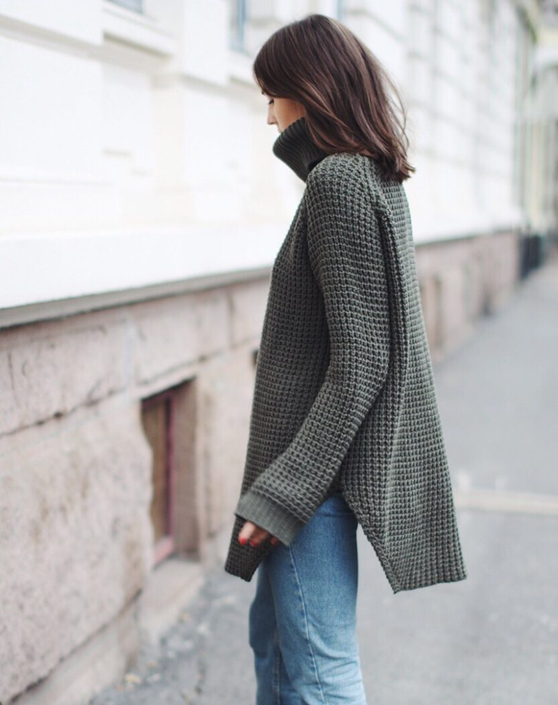 Darja Barannik wears the turtle neck trend in this cute grey knit.  Coat: Michael Kors, Jeans: American Apparel, Sweater: Hope, Shoes: Camilla Pihl X Bianco.