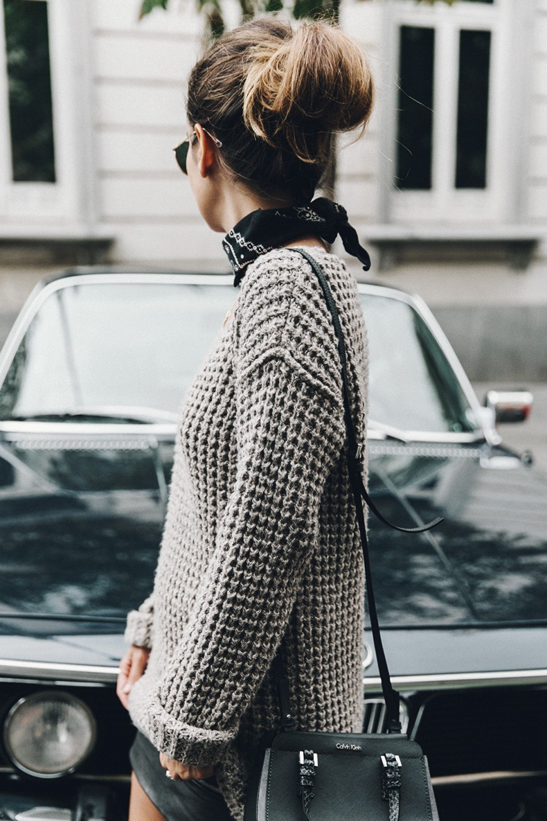 Sara Escudero wears a chunky knitted pullover with a CK cross over handbag and a leather mini skirt. Bag/Jumper: Calvin Klein.