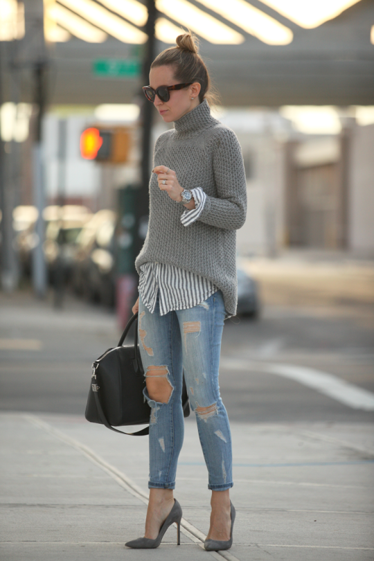 Magdalena Knitter wears a simple grey H&M knit with denim jeans and a stylish Celine handbag. Jacket: Vintage, Shoes: Gianvito Rossi, Jeans: DIY, Knitwear: H&M, Bag: Celine.