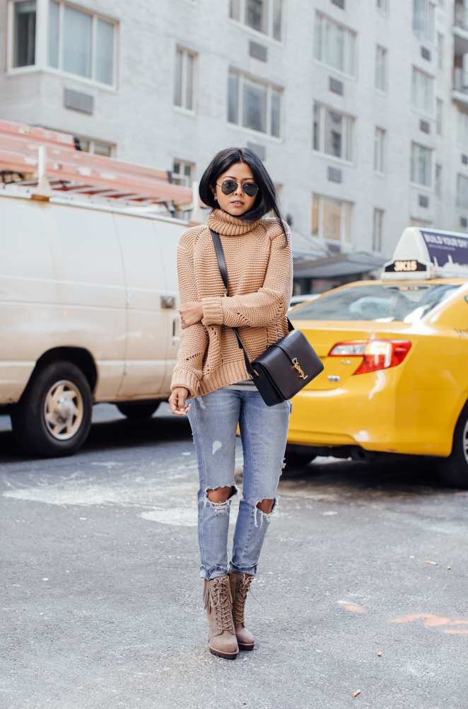 Pale knitwear looks great worn with washed out denim. Sheryl Luke wears the look with a pair of gorgeous Kenneth Cole heeled boots. Top: Joes Jeans, Jeans: Zara, Bag: YSL, Boots: Kenneth Cole.