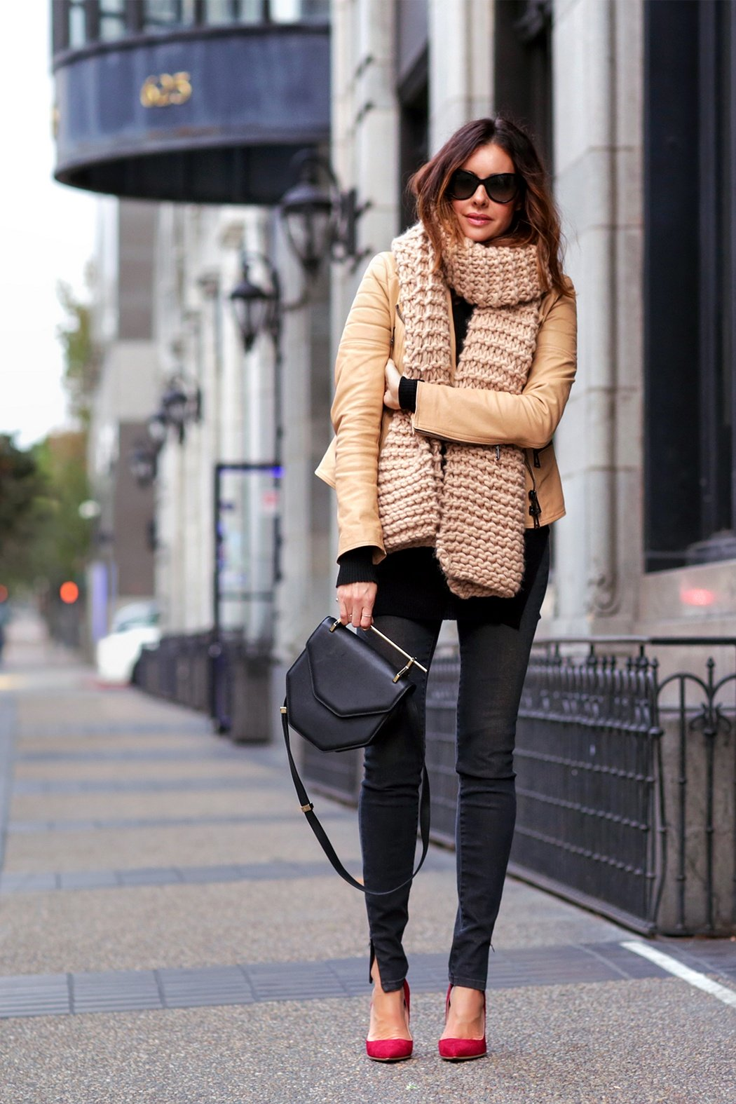 The puffer jacket trend is experiencing a revival this season. Erica Hoida accessorises this camel coat with a gorgeous chunky knit scarf; the ultimate winter piece. Jacket: Belstaff, Shirt: Helmut Lang, Jeans: Victoria Beckham, Shoes: Rupert Sanderson, Scarf: I Love Mr. Mittens , Bag: M2Malletier.
