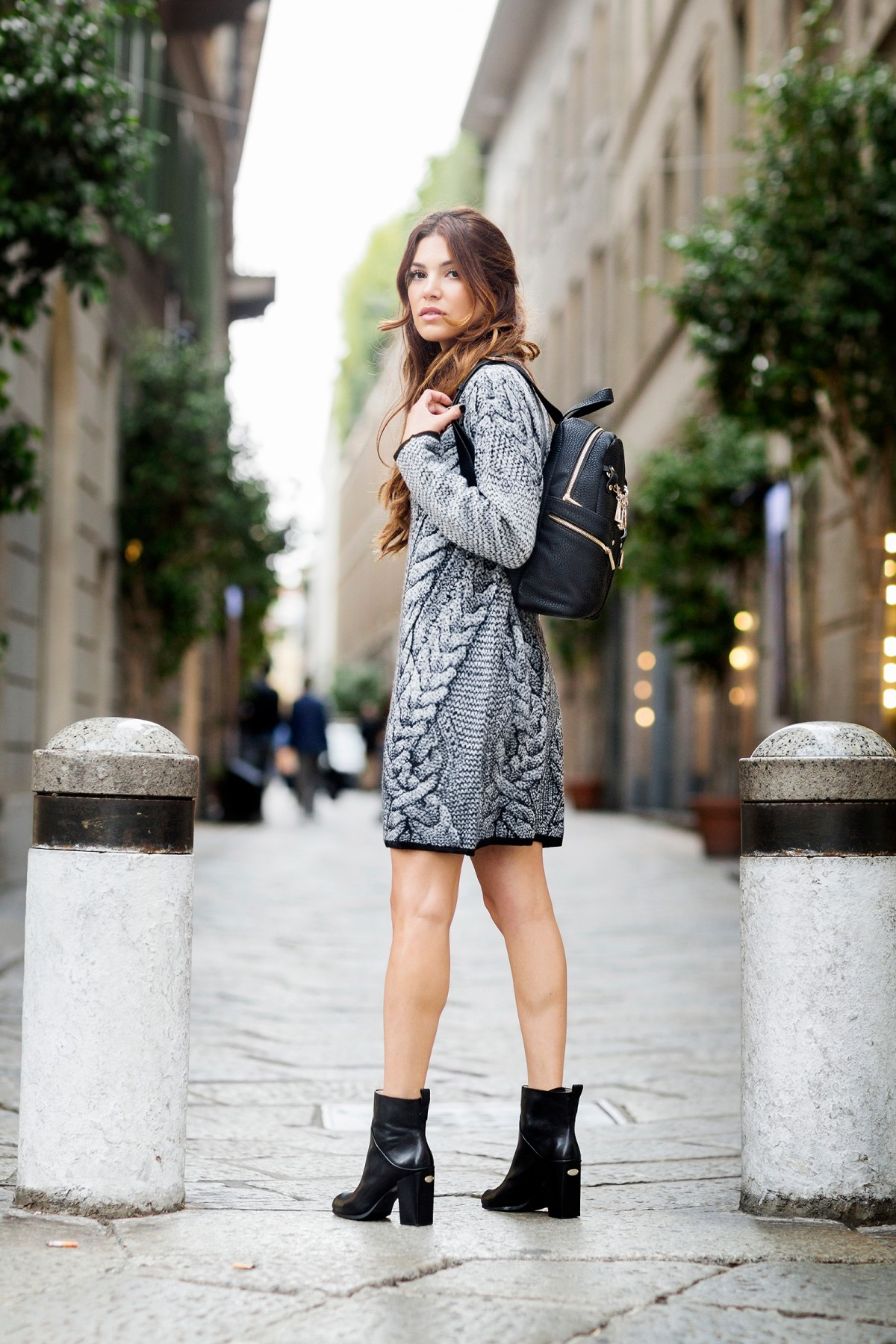 We love this long-sleeve knit dress. The black trim and an unusual weave of the fabric make the dress distinctive; it looks ultra cool worn with ankle boots and a leather backpack. Via Negin Mirsalehi. Dress/Shoes/Bag: Liu Jo.