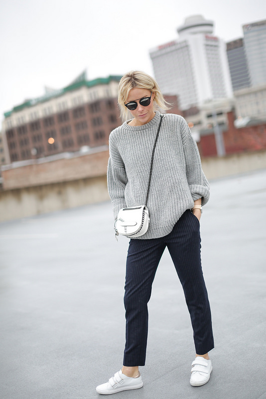 This effortlessly casual look is perfect for almost any occasion. We recommend stealing Mary Seng's style by wearing slacks with knitwear in order to get that cosy winter feel. Knit: Zady, Trousers: Ann Taylor, Sneakers: Zara, Bag: Coach.