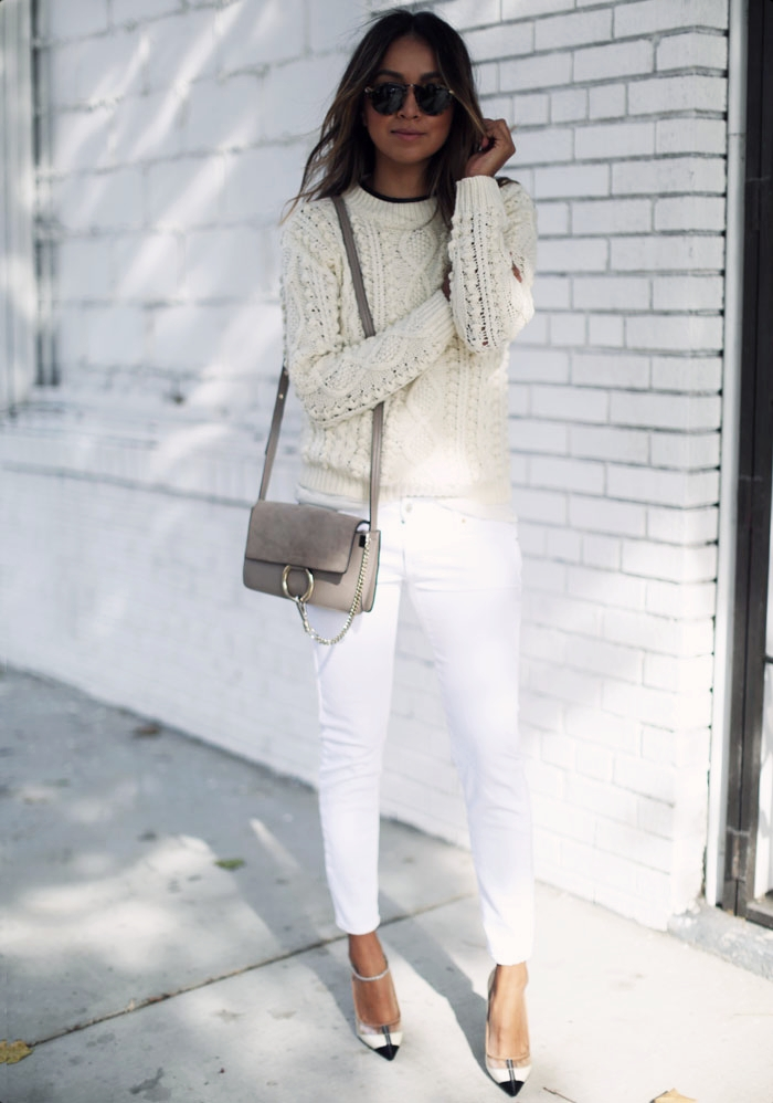 Cream knitwear is always a winner, and can often make the perfect winter look! Julie Sarinana appears ready for winter in this gorgeous knit sweater and white denim jeans. Sweater: Storets, Jeans: Zara, Bag: Chloe.