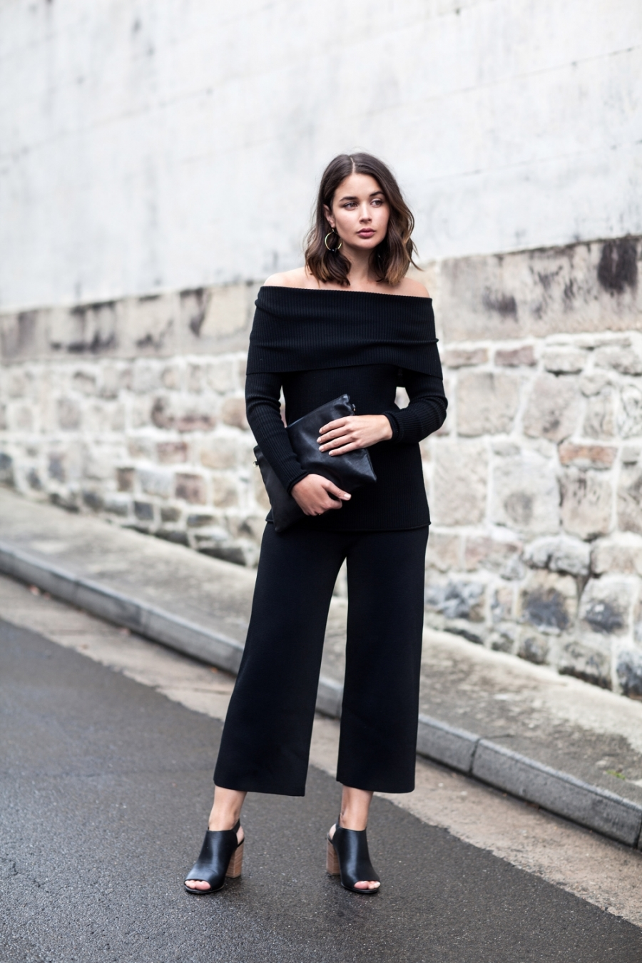 Sara Donaldson is rocking this trendy off the shoulder sweater, paired with black culottes and heeled sandals. This look is unique and authentic; a perfect statement knitwear look. Top/Trousers/Shoes: Country Road.