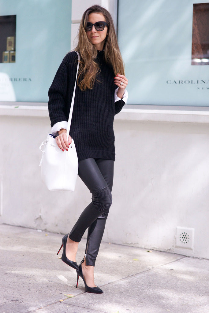 Arielle Nachami keeps it simple but stylish in a black knitted jumper and leather leggings.   Trousers: Anine Bing, Shoes: Christian Louboutin, Sweater: GUESS, Button Down: Elizabeth and James.