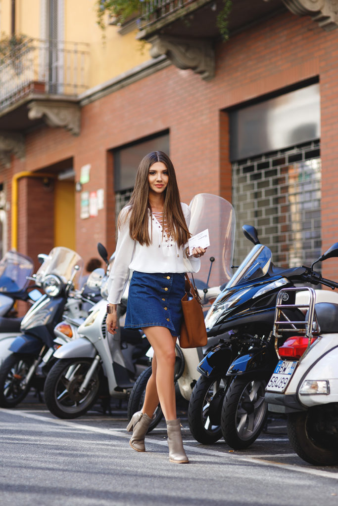 This denim button front skirt looks ultra cute with a lace up detailed blouse. Via Larisa Costea.  Blouse/Skirt: Romwe, Bag: Michael Kors.