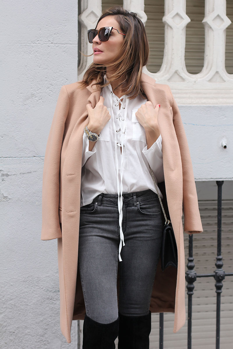 Lace up detailing is finest on sheer blouses like this one modelled by Silvia Garcia. Wear your own alternative with jeans and a pale coloured coat. Coat: Purification Garcia, Blouse: Sheinside, Jeans: Zara.
