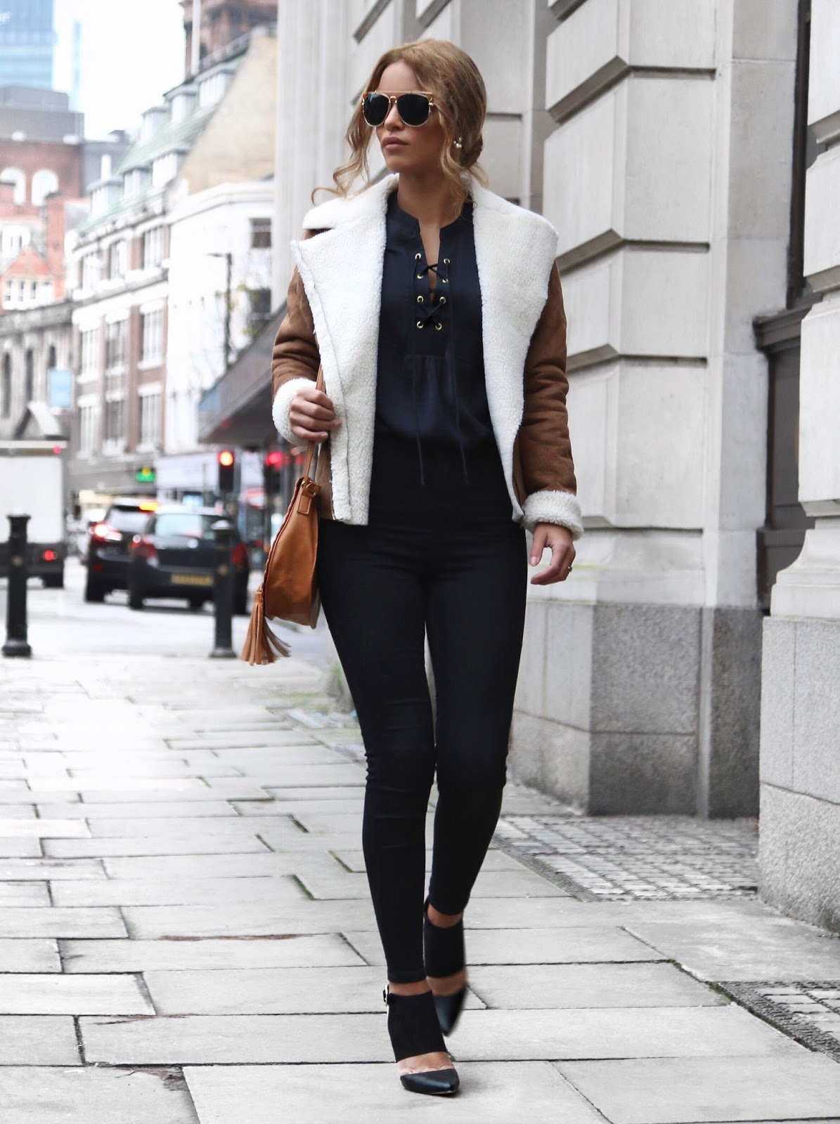 Nada Adelle wears the lace up trend on a gorgeous navy blouse, matched perfectly with a leather shearling coat and high waisted black denim jeans. Biker Jacket/Shoes: Dorothy Perkins, Jeans: Topshop.