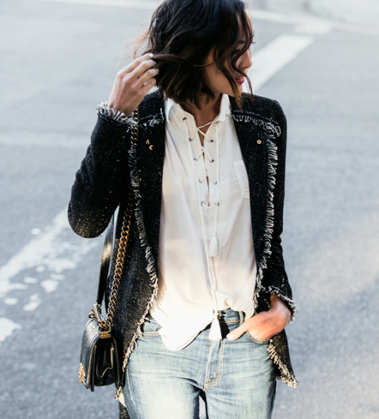 Chriselle Lim wears the lace up trend on a beautifully simple white blouse from Faithfull, paired with an authentically sophisticated tweed jacket and denim jeans. We love the simplicity of this look! Tweed Jacket: Rebecca Taylor, Blouse: Faithfull, Jeans: Mother Denim, Shoes: Reed Krakoff.