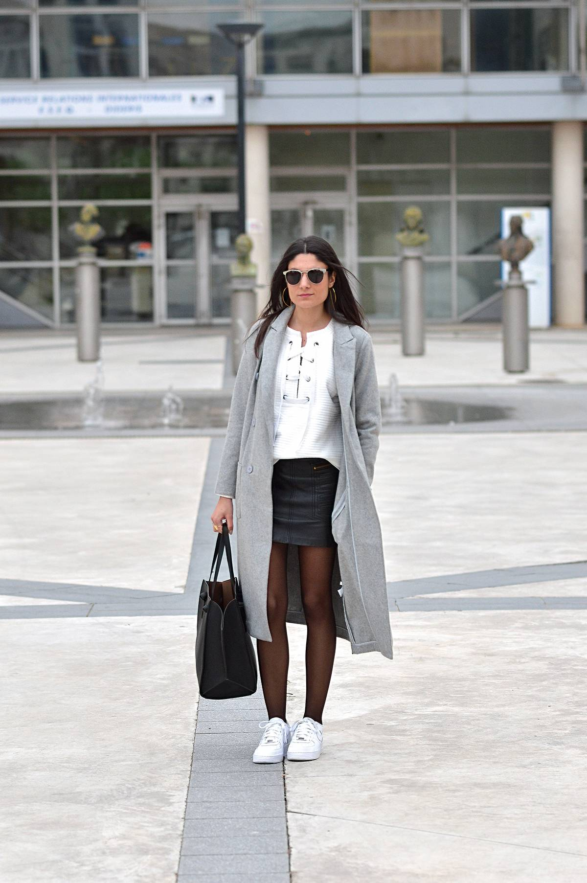 Federica L. looks ultra stylish and contemporary in this striking lace up sweater from Shein, worn here with a leather mini skirt and a marl grey maxi coat. Finish this look off with a pair of simple white sneakers to steal Federica's style. Outfit: Shein.