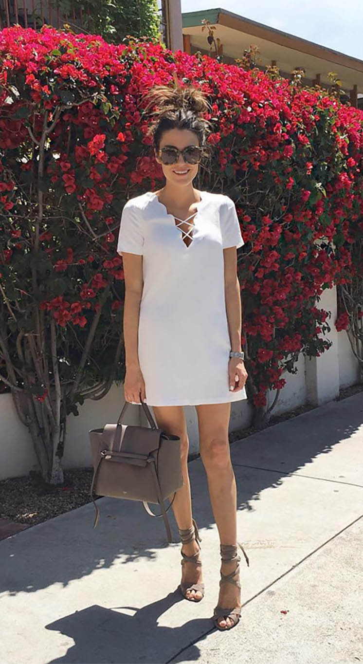 This cute white dress demonstrates another fabulous way to wear the lace-up trend; as part of the plunge neckline detailing! Christine Andrew looks trendy and ready for summer in this mini dress, paired with gorgeous gladiator sandals. Dress: Ily Couture, Shoes: Nordstrom.