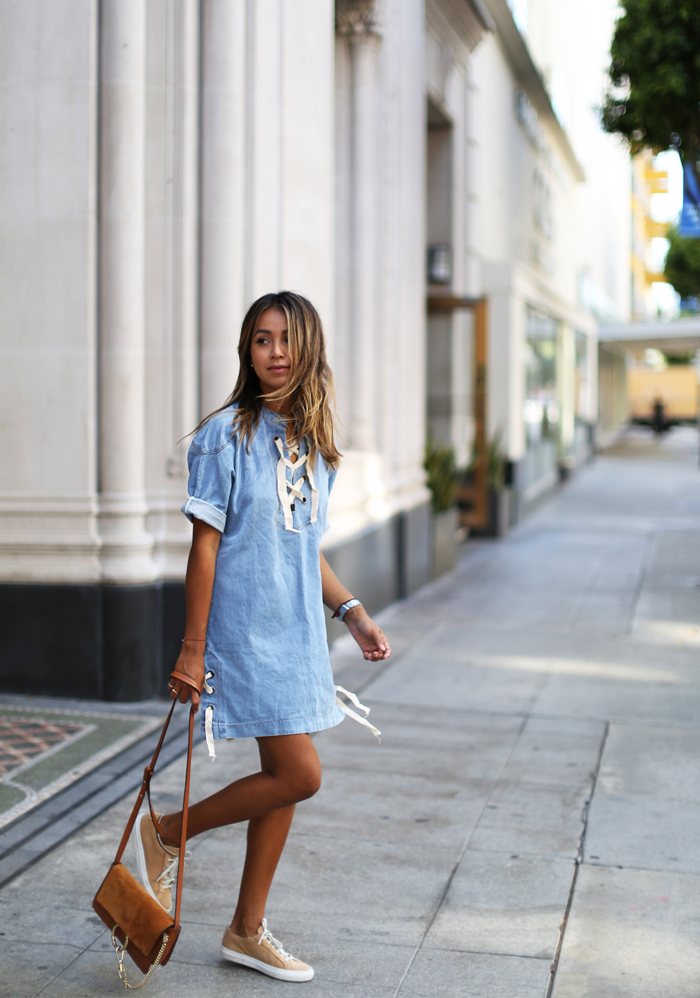 This cute pastel blue lace up dress is an absolute win with a leather bag and canvas shoes. Via Julie Sarinana. Dress: Storets.