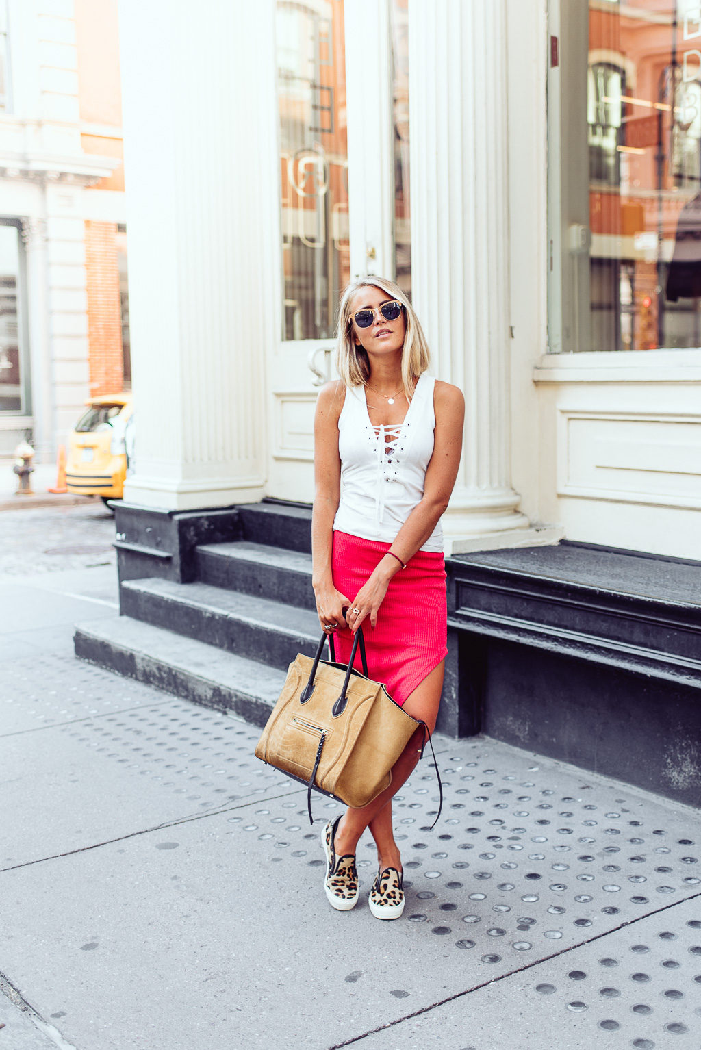 Janni Deler wears simple white lace up vest with a statement red skirt and cute cheetah canvas shoes. Top/Skirt: Gina Tricot, Shoes: Daniel.