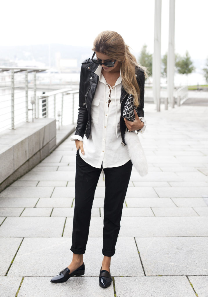 This white lace up blouse looks ultra cool with black cigarette trousers and a leather jacket. Via Annette Haga.  Jacket: The Kooples, Shirt: Zara, Clutch: By Malene Birger, Pants: Helmut Lang.