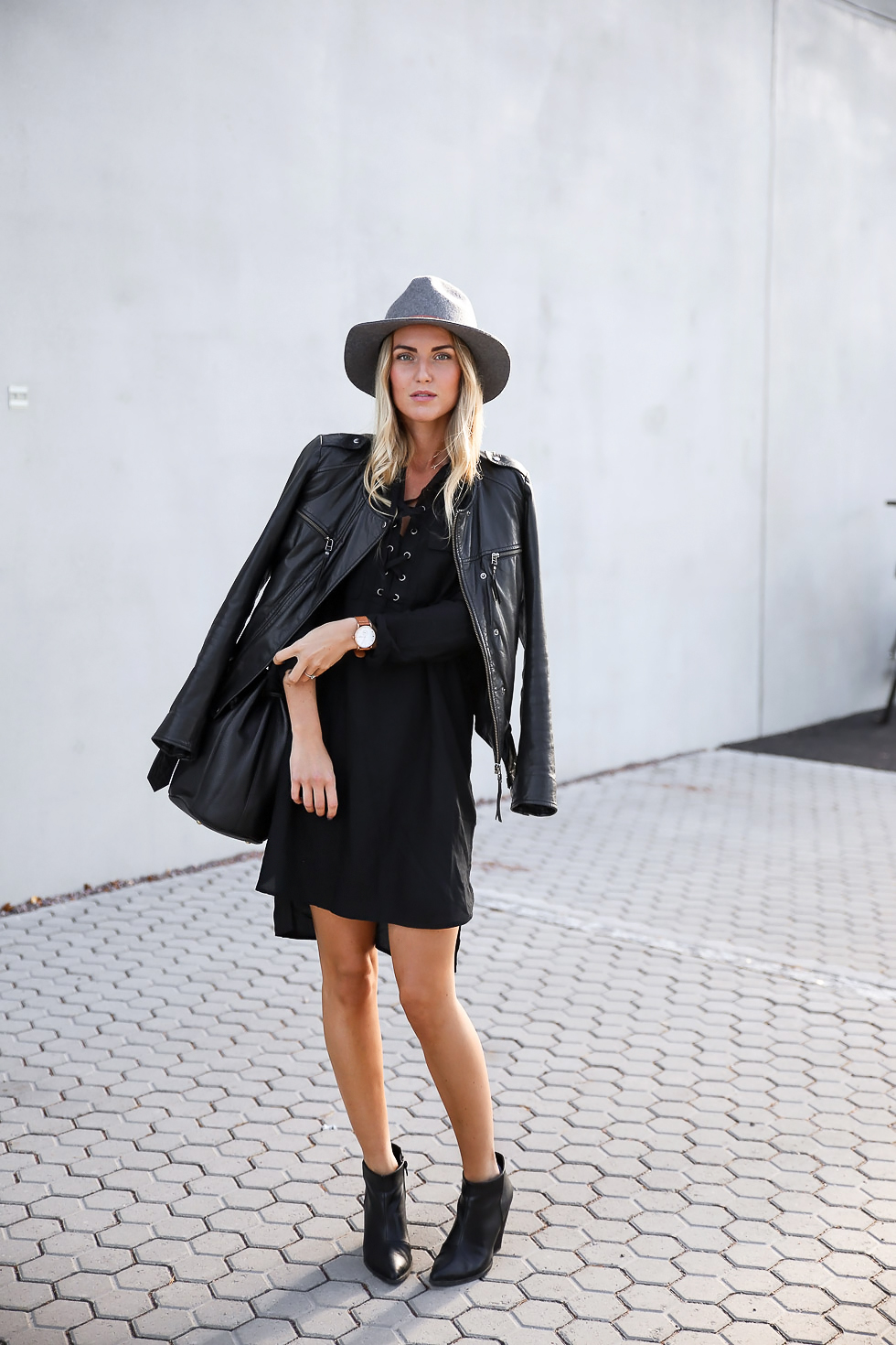 Lace up detailing adds dimension to this little black dress; try to find something similar and pair with a leather jacket for a sophisticated look. Via Kristin Sundberg. Dress: Lindex, Bag: Status Anxiety, Boots: H&M.