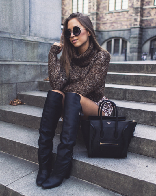 Kenza Zouiten rocks the classic fall pullover with her over the knee boots. Boots/Jumper: H&M.
