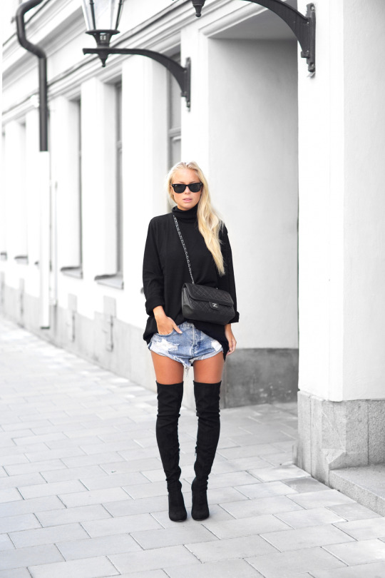 You can't go wrong with black over the knee boots; pair yours with loose denim shorts and a black knit to recreate this look. Via Victoriatornegren.se.  Brands not specified.