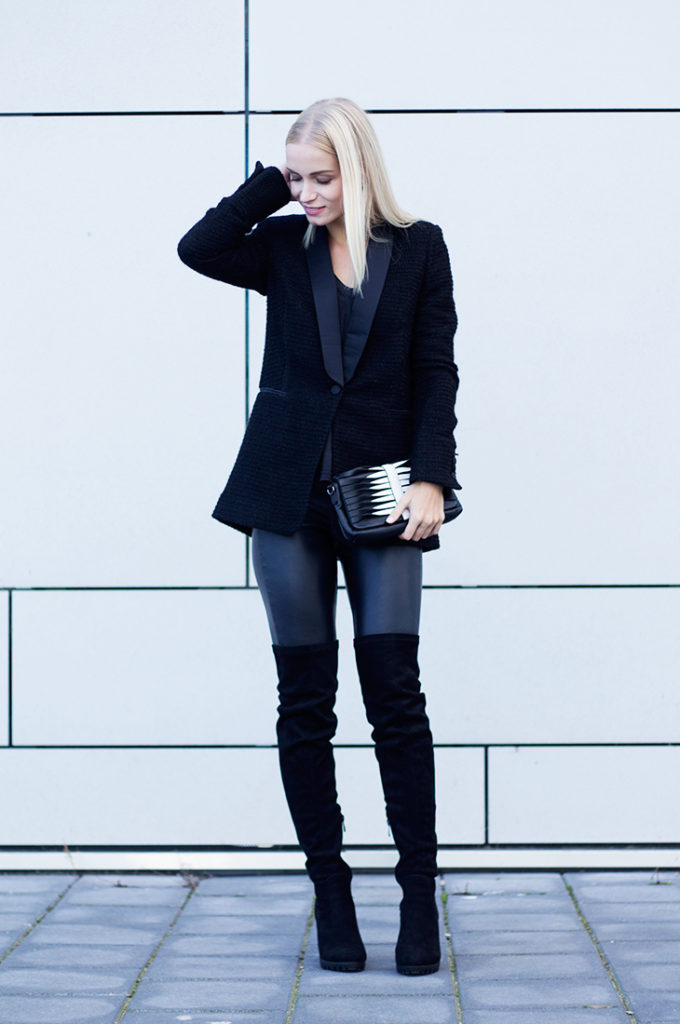Leather trousers can also look great with over the knee boots. Try a black blazer and bag combination as seen here for a cool and casual look. Via Fashion-attacks.com.   Blazer: Atos Lombardini, Shirt: Zara, Trousers: H&M, Boots: Publice Desire.