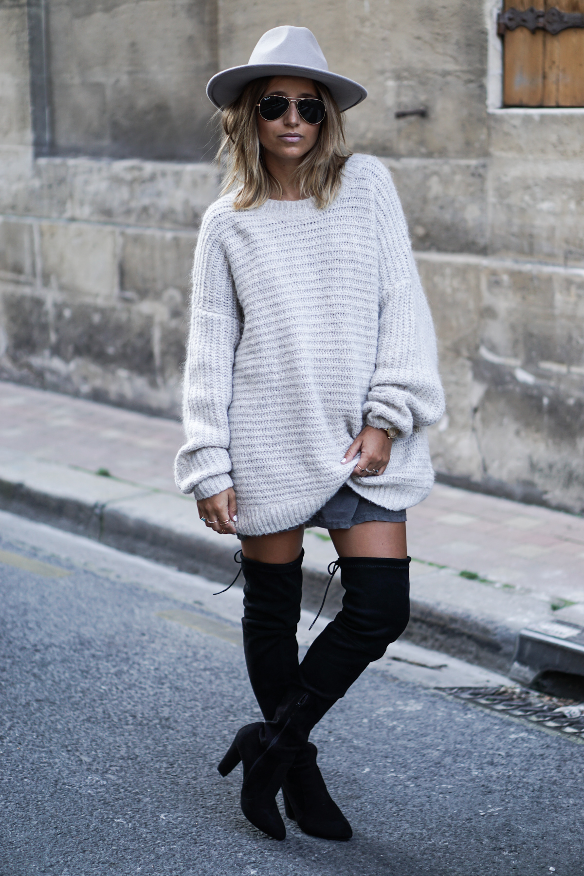 Camille Callen pairs a chunky knitted jumper and snazzy fedora with her black over the knee boots. Jumper: My Sunday Morning.