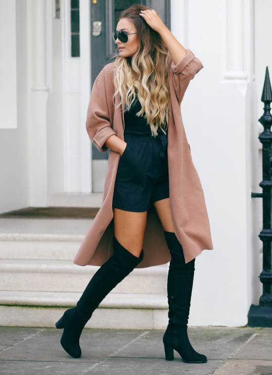 91f57153f8f These sleek black over the knee boots look great with an oversized beige  coat and shades